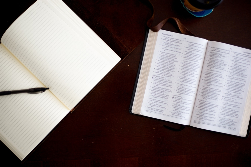 blank notebook and bible on table