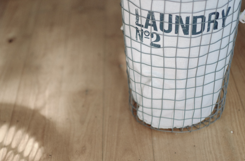 Laundry basket on a wooden floor